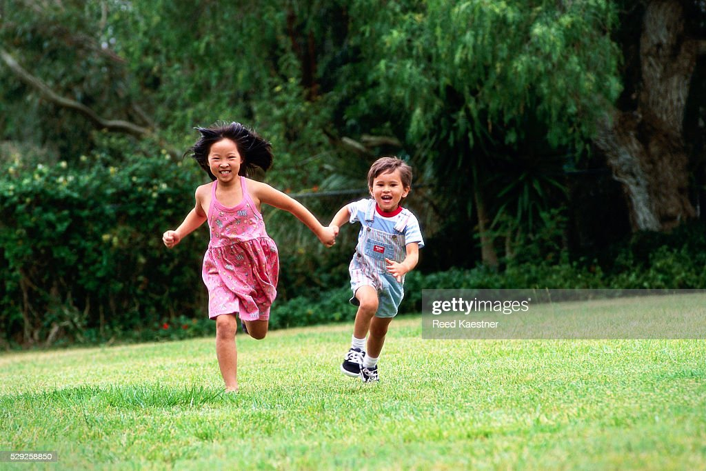Brother and Sister Running : Stock Photo
