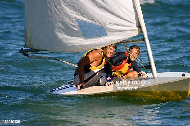 Brother and sister sailing in small dinghy