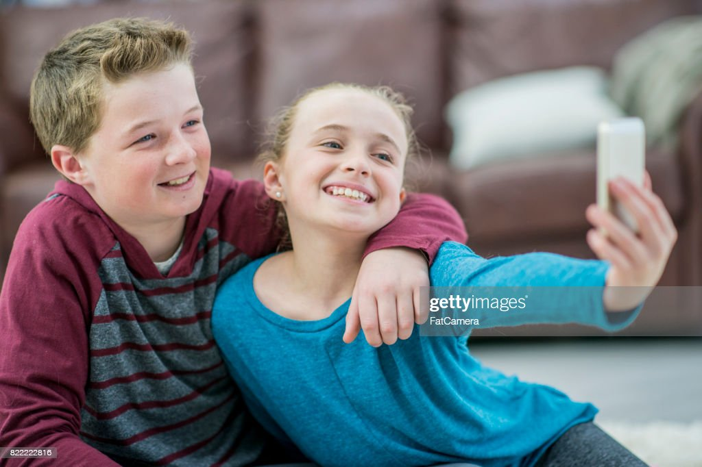 Brother And Sister Selfie : Stock Photo
