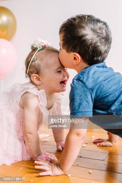 Brother and sister, siblings, big brother, little sister, family, love, togetherness, kiss on forehead, brother kissing his sister, brother and sister playing, kids playing