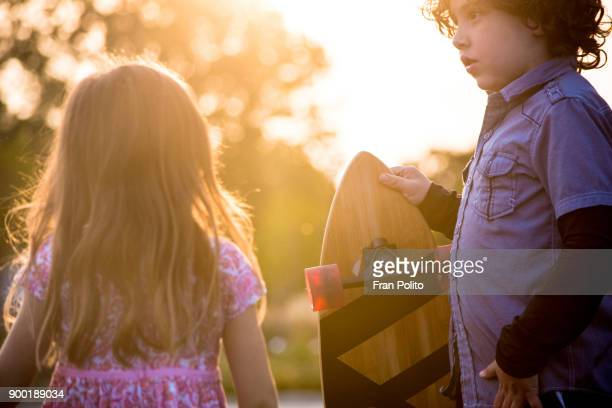 brother and sister skateboarding. - baldwin brothers stock pictures, royalty-free photos & images