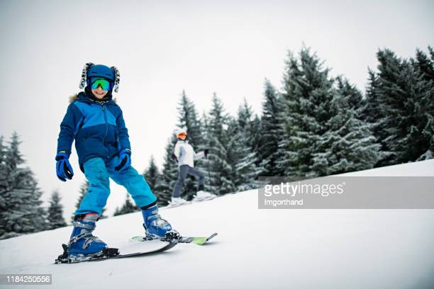 brother and sister skiing - imgorthand stock photos and pictures