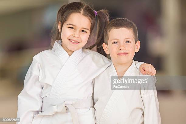 brother and sister taking taekwondo - taekwondo kids stock photos and pictures