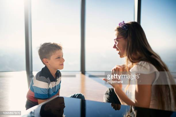 brother and sister talking in sign language - sinal imagens e fotografias de stock