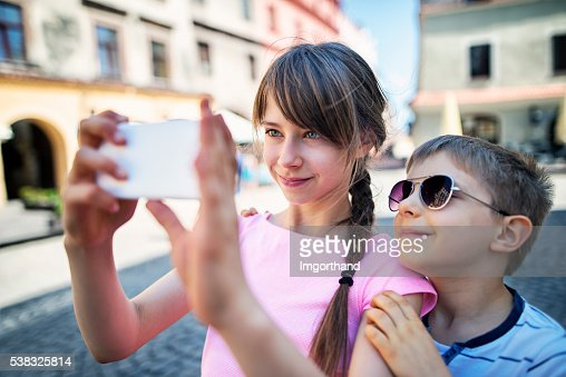 Brother and sister tourist taking selfie