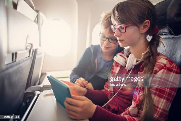 Brother and sister travelling in plane
