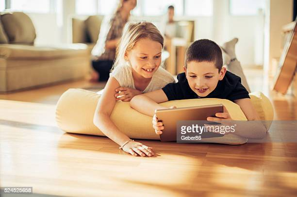 Brother and sister using digital tablet