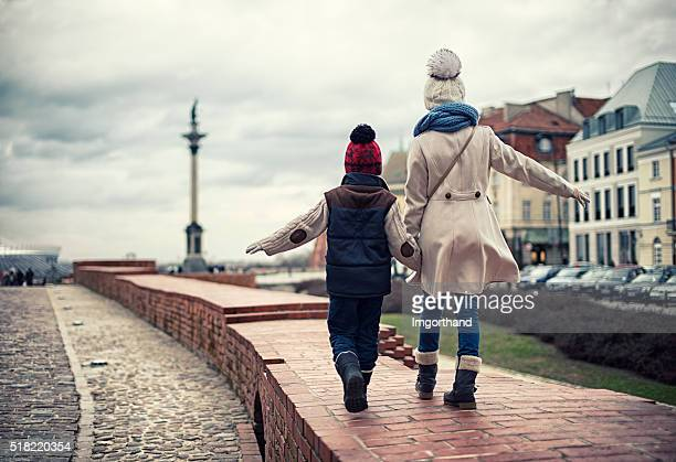 brother and sister visiting warsaw - coat stock pictures, royalty-free photos & images