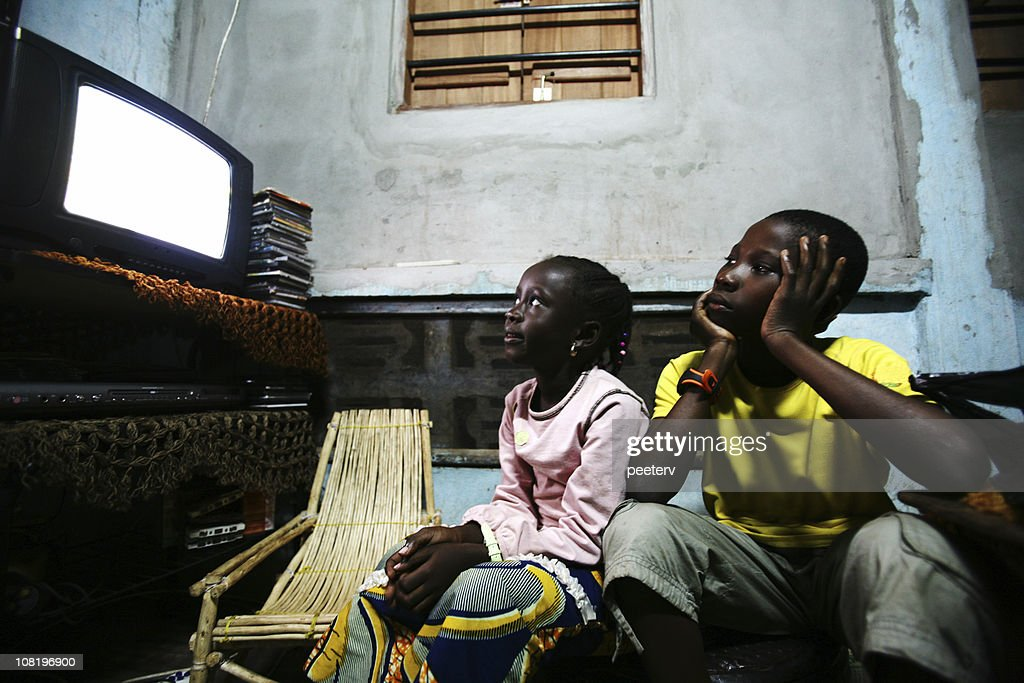 Brother and Sister Watching Television : Stock Photo
