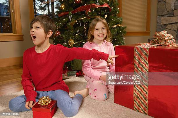 Brother and sister with Christmas gifts