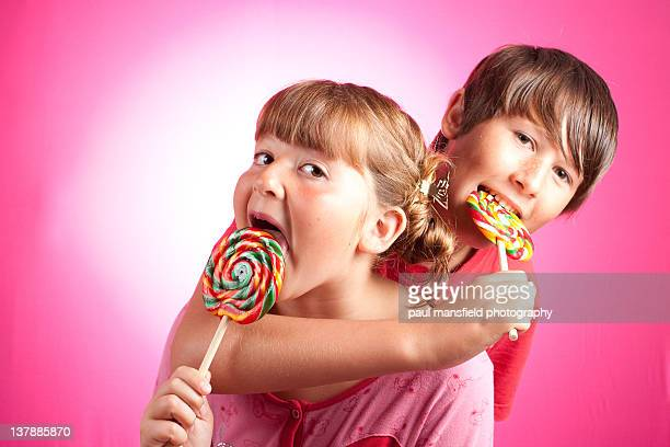 Brother and sister with lollipops