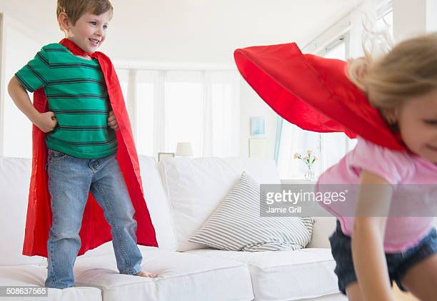 Brother and sisters playing superheros