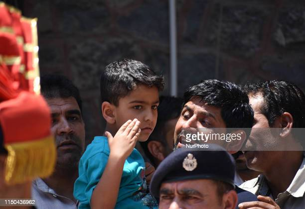 Brother and son of Station House Officer Arshad Khan attend the wreath laying ceremong in district police lines in SrinagarKashmir on June 17 2019...