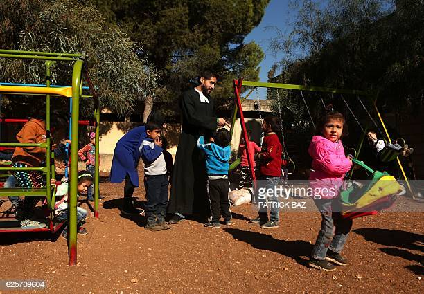 Brother Andres a Mexican cleric with the Brothers of the Christian Schools plays with refugee children from Syria at the Fratelli project in the...