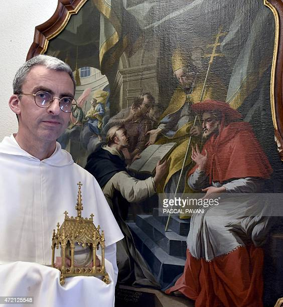 Brother Augustin Laffay historian of the Dominican Order of the SaintThomas Aquinas monastery in Toulouse stands in front of a Saint Dominic painting...