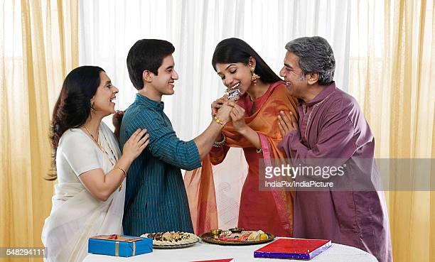 brother feeding his sister during rakhi - mangala sutra fotografías e imágenes de stock