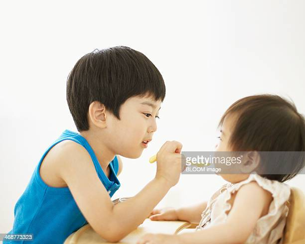 Brother Feeding His Sister