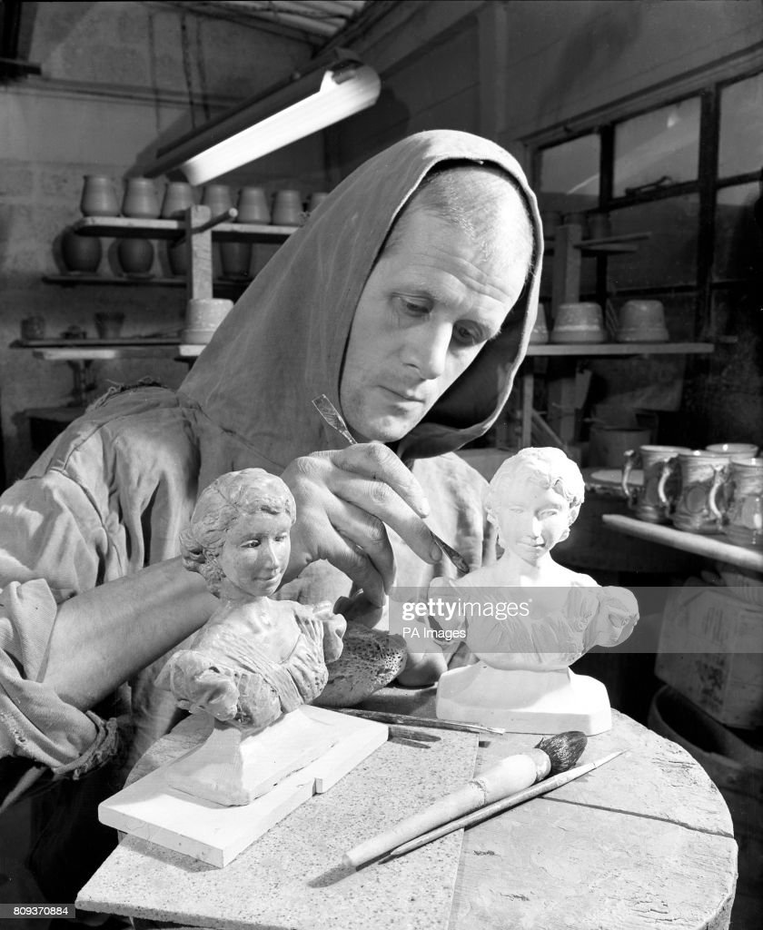 Brother Gilbert working on miniature busts of the Queen at
