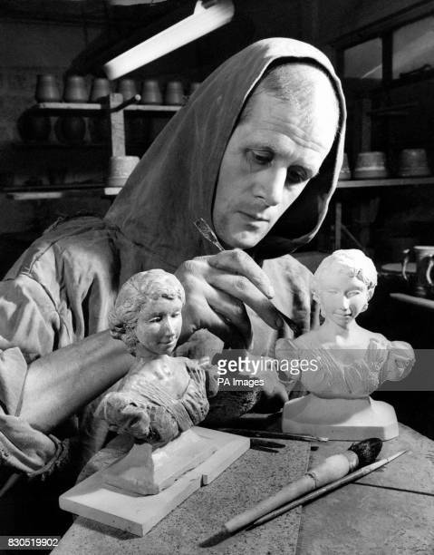 Brother Gilbert working on miniature busts of the Queen at Prinknash
