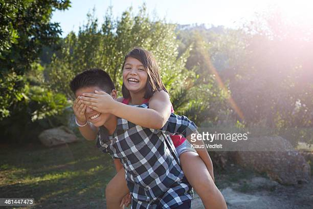 brother having sister on the back - klaus vedfelt mallorca stock pictures, royalty-free photos & images