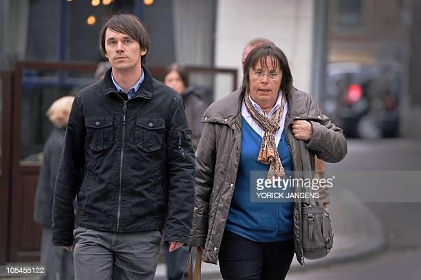 Brother of Els Clottemans Koen Clottemans and her mother Martine De Kegel walk in front of the Limburg Assize Court in Tongeren on October 14 2010...