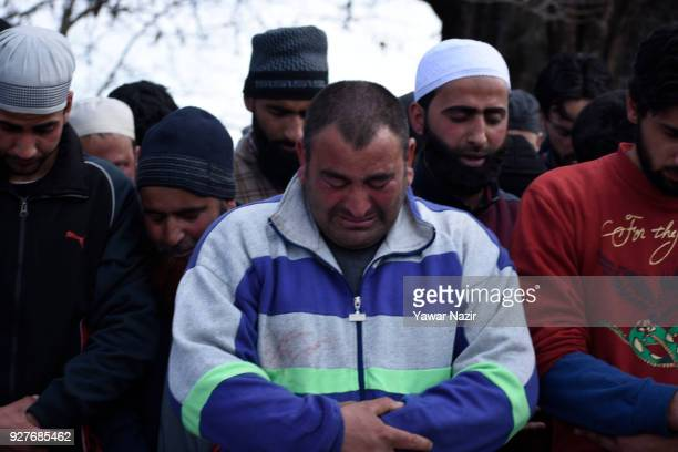 Brother of Suhail Ahmad a civilian killed by Indian army mourns as he prays during his funeral on March 05 2018 in Pinjura Village 52 Kilometer south...