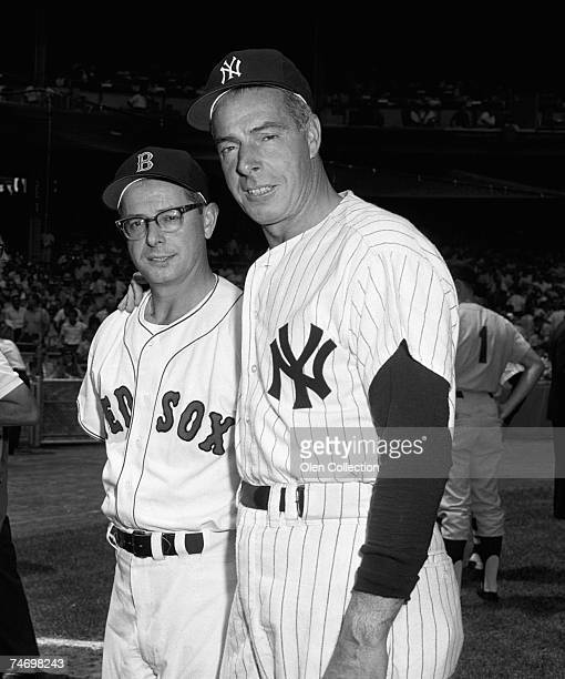 Brother outifelders Dom DiMaggio of the Boston Red Sox and Joe DiMaggio of the New York Yankees pose for a portrait together prior to the annual Old...