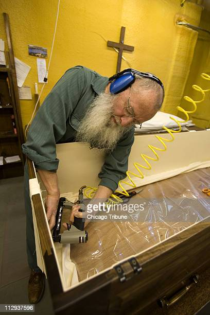 Brother Paul Halaburt, a Cistercian monk, builds a casket at New Melleray Abbey in Peosta, Iowa. The monks have been making simple wooden caskets...