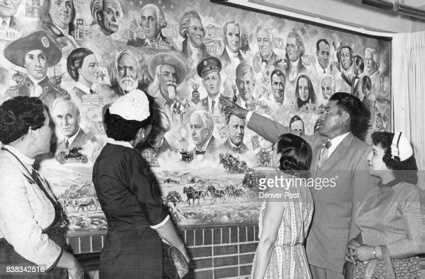 Brother Portrayed in Honor Mural Delfinio Martinez of Ault Colo points to the portrait of his brother Joe P Martinez In the Great American Mural...