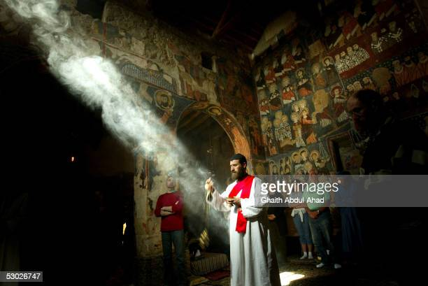 Brother Putros a Syrian monk swings incense durring mass in the church of the Monastery of St Moses the Abyssinian May 19 2005 east of Nebek Syria...
