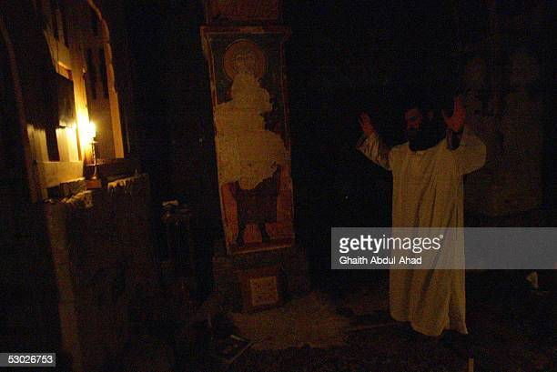 Brother Putros prays in front of the altar of the church in the Monastery of St Moses the Abyssinian May 18 2005 east of Nebek Syria The 11th century...