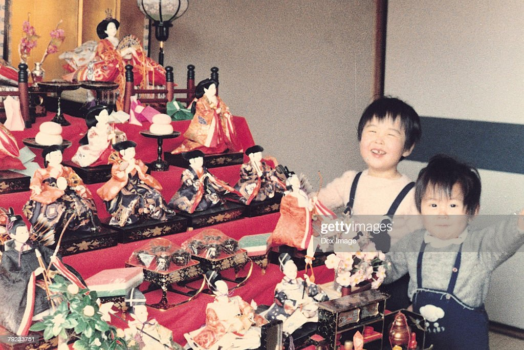 Brother, sister and Japanese figurines : Stock Photo