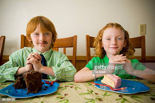 brother & sister with messy cake