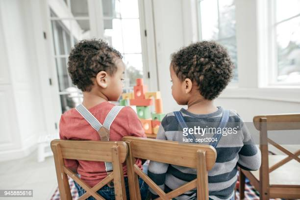 brother sitting side by side - suspenders stock pictures, royalty-free photos & images