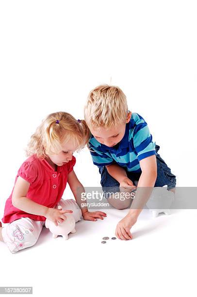 brother teaching little sister to save