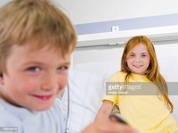 brother visiting sister in hospital - patients brothers stock pictures, royalty-free photos & images