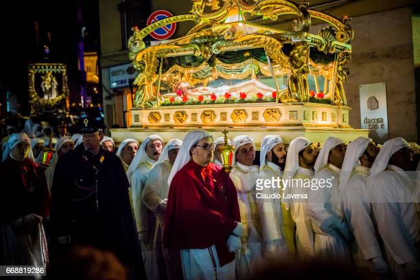 Brotherhoods carry a statue of Jesus Christ during the Good Friday procession through the streets of Enna on April 14 2017 in Enna Italy The Good...
