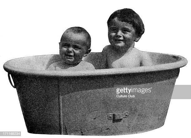 Brothers Adrian and Denis Conan Doyle sitting in a bath tub Sons of Sir Arthur Conan Doyle Scottish author and creator of Sherlock Holmes 22 May 1859...