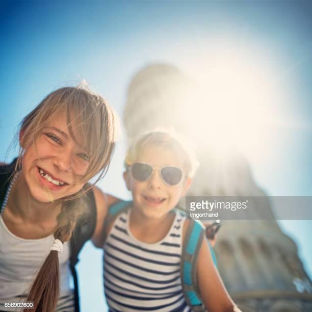 Brothers and sister having fun in Pisa