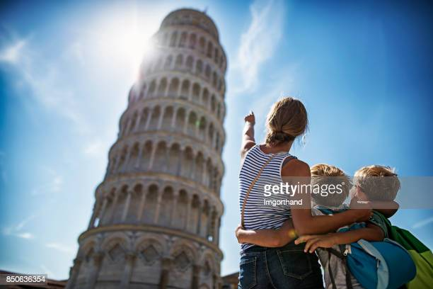 brothers and sister sightseeing in pisa - pisa stock pictures, royalty-free photos & images
