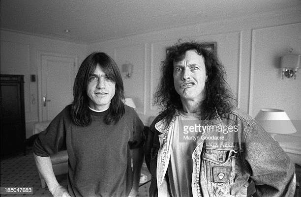 Brothers Angus Young and Malcolm Young of AC/DC portrait in hotel room Germany 1995