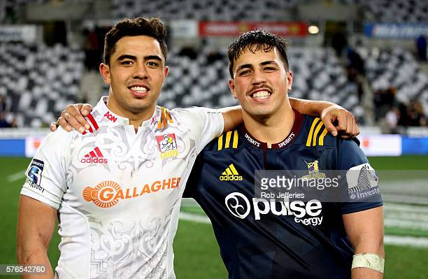 Brothers Anton LienertBrown of the Chiefs and Daniel LienertBrown of the Highlanders pose for a photo after the round 17 Super Rugby match between...