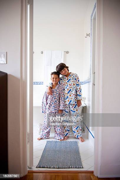 brothers, bathroom portrait in pajamas