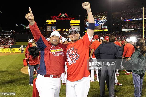 Brothers Bengie Molina and Yadier Molina of the St Louis Cardinals celebrate after the Cardinals defeated the Los Angeles Dodgers 90 to win the...