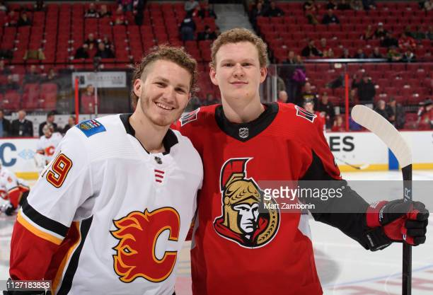 Brothers Brady Tkachuk of the Ottawa Senators and Matthew Tkachuk the Calgary Flames pose for a photo during warm up prior to a game at Canadian Tire...
