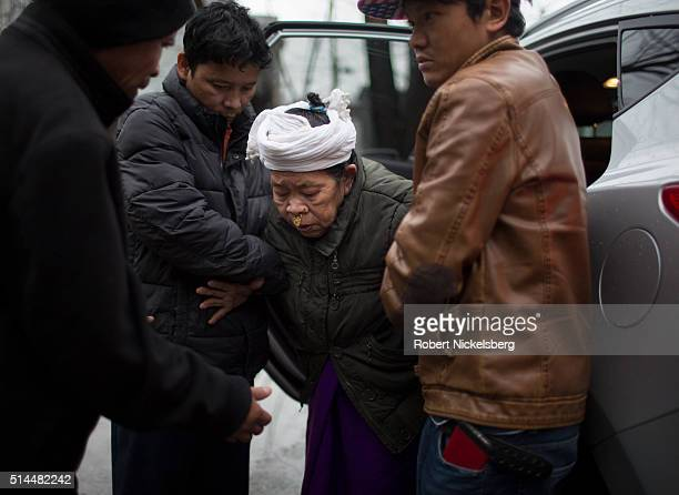 Brothers Dambar and Dil Gurung along with their cousin Bhim Gurung help their mother Man Maya Gurung out of a car Burlington Vermont February 3 2016...