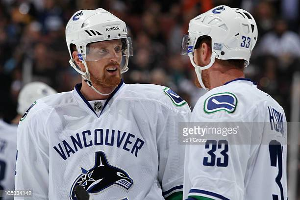 Brothers Daniel Sedin and Henrik Sedin of the Vancouver Canucks speak during their game against the Anaheim Ducks at Honda Center on October 13 2010...