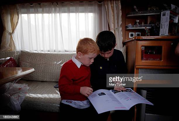 Brothers Dennis and John Sheridan read together in their trailer outside the Dale Farm site on October 18, 2013 in Crays Hill, England. Two years on...