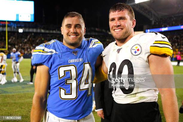 Brothers Derek Watt of the Los Angeles Chargers and T.J. Watt of the Pittsburgh Steelers pose for a photo following a game at Dignity Health Sports...