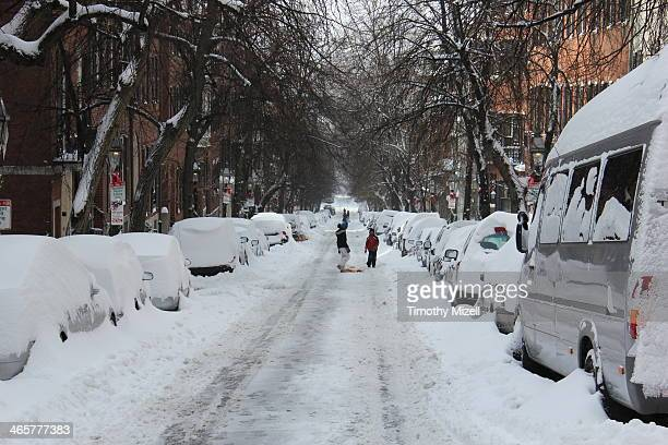 CONTENT] Brothers discuss who gets the next downhill sleigh ride the morning after Snowstorm Hercules clears out of Boston